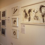Gallery wall featuring work by Annie Burrows and Hannah Buckley
