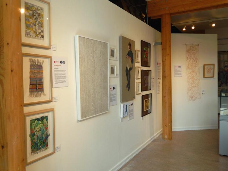 Gallery wall featuring work by Harriet Brigdale, Renate Wilbraham, Sheri Gee, Susan Dodds and Jackie Watkins