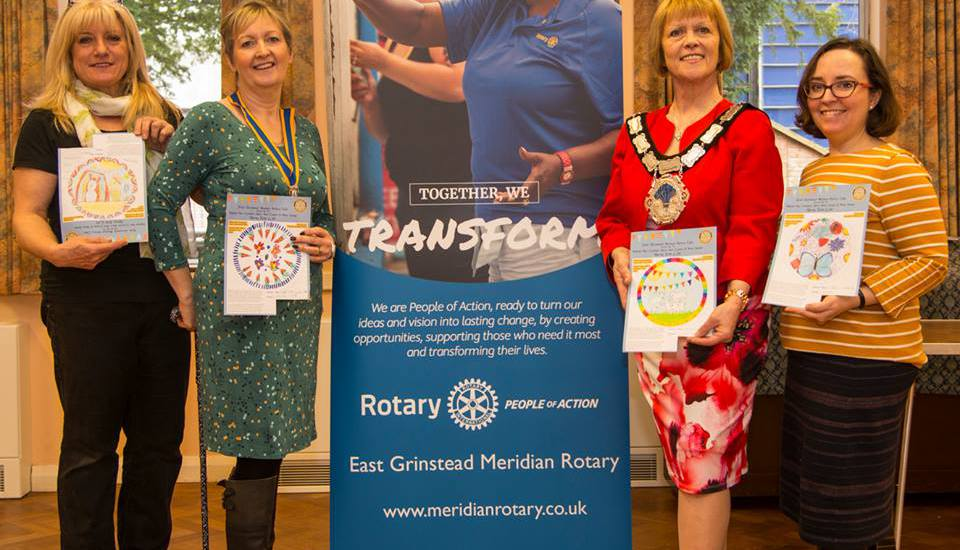 Judges of the East Grinstead Meridian Rotary and Doodledish competition to design a plate, holding the winning entries