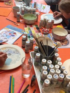 children recreating their winning designs onto plates